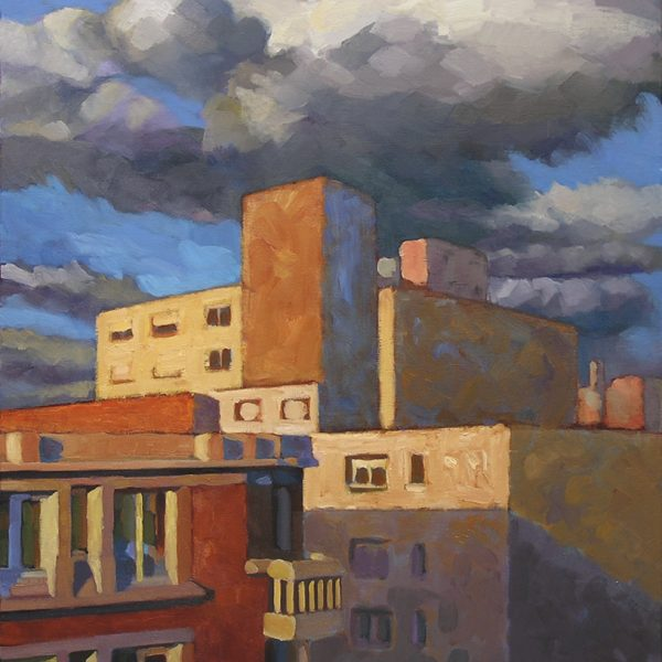 immeubles ocres et ciel nuageux